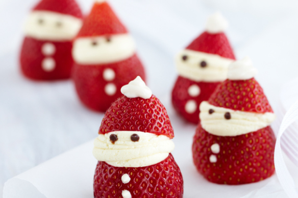 Little santas made out of fresh strawberries and cream.