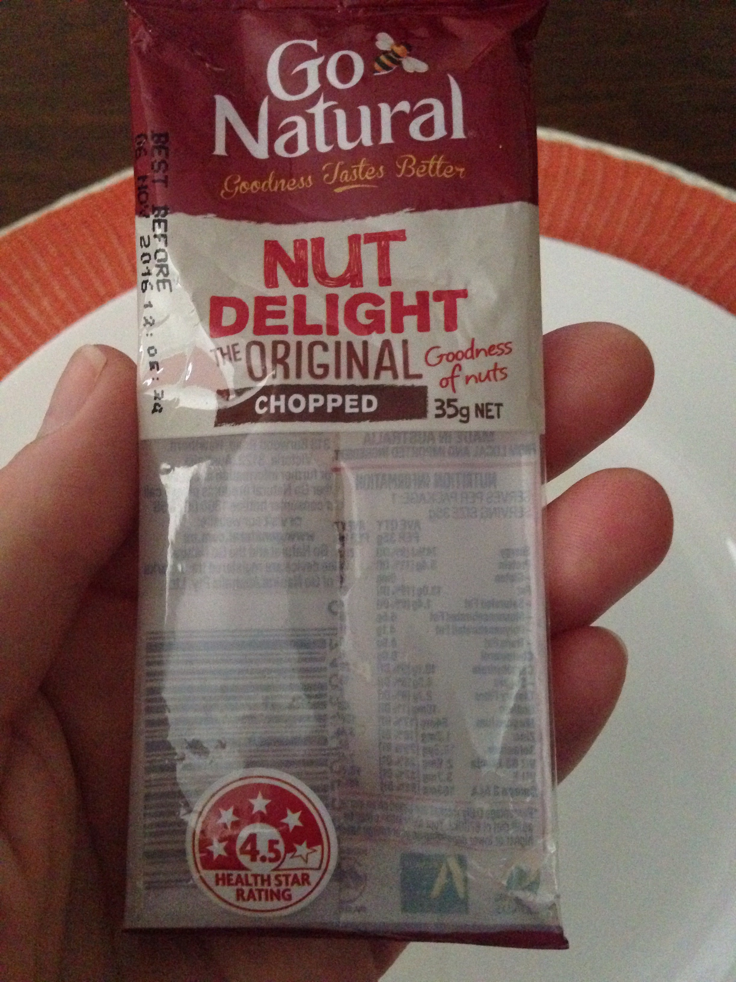 A close up of the packet of Go Natural Nut Delight bar.